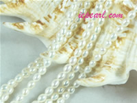 ivory white 2-2.8mm rice freshwater pearl strand
