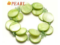 shell bracelet with green crystal beads by spring line