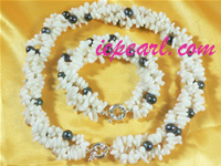 white pearl necklace set with white coral beads